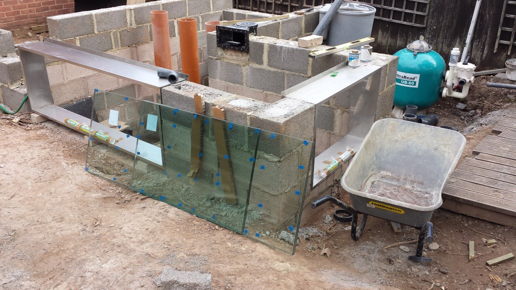L-shape pond build with two pond window frames made of stainless steel