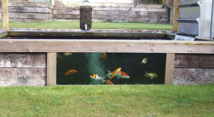 Wooden railway sleeper pond kits atlantica gardens koi for Wooden koi pool