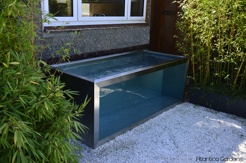 Modern ponds with windows outdoor waterfeatures troughs for Outdoor fish tank uk