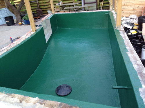 Fiberglassed concrete pond with koi pond window frame and glass